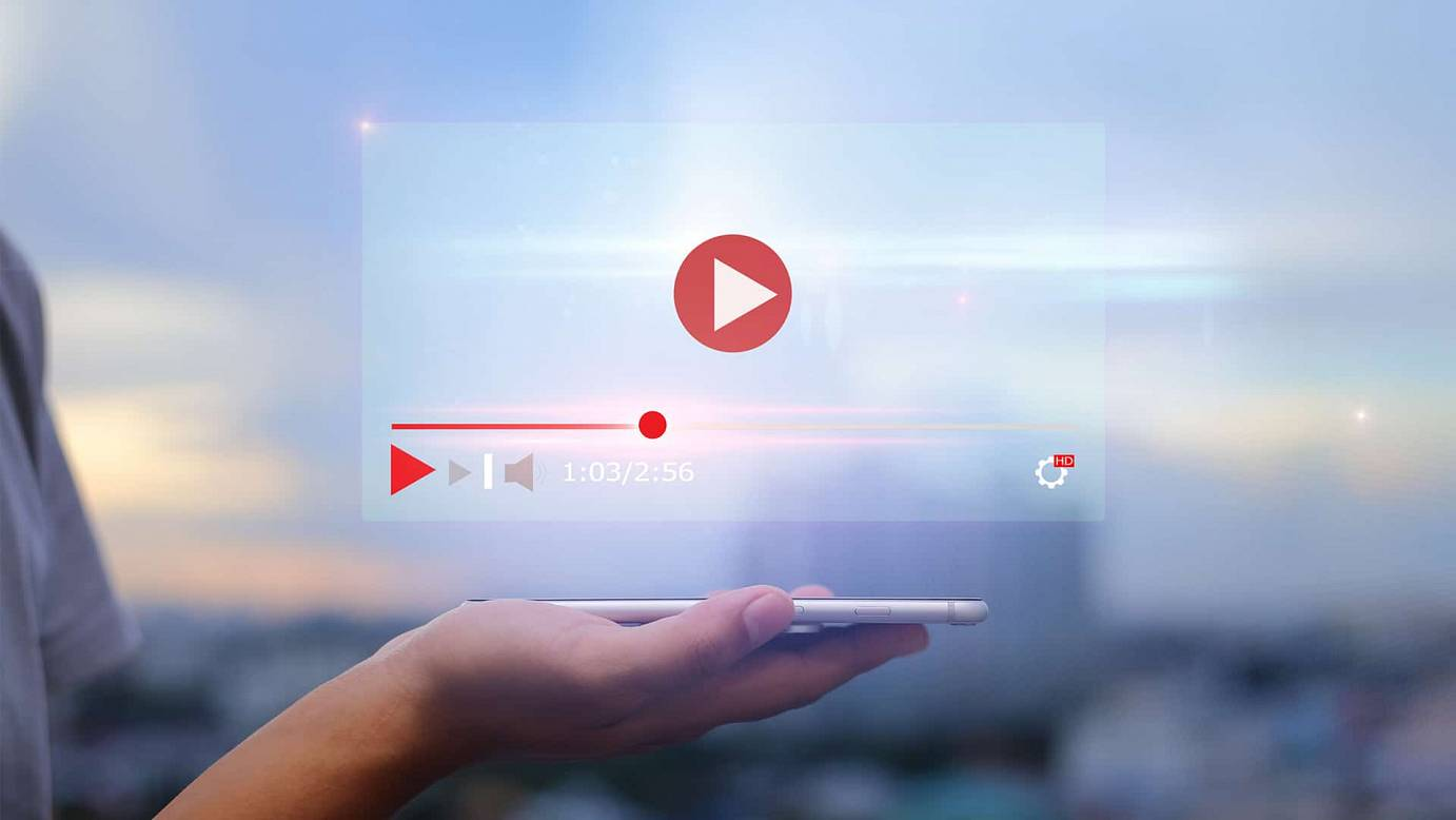 live video content online streaming marketing concept hands holding mobile phone blurred urban city